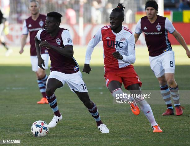 Colorado Rapids defender Bobby Burling kicks the ball down field against the defense of New England Revolution forward Kei Kamara in the first half...