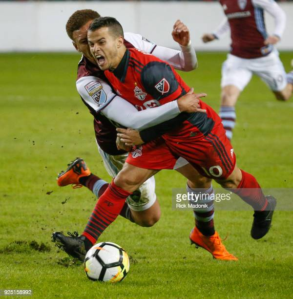Colorado Rapids defender Kortne Ford grabs on and pulls down Toronto FC forward Sebastian Giovinco who was awarded a free kick Toronto FC vs Colorado...