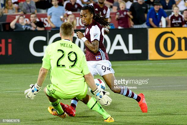 Colorado Rapids defender Marlon Hairston takes a shot on Sporting Kansas City goalie Tim Melia during the game at Dick's Sporting Goods Park on July...