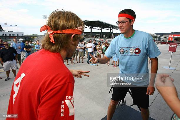 Colorado Rapids fans participate in a rock paper scissors competition prior to the match against the Columbus Crew on July 27 2008 at Dicks Sporting...