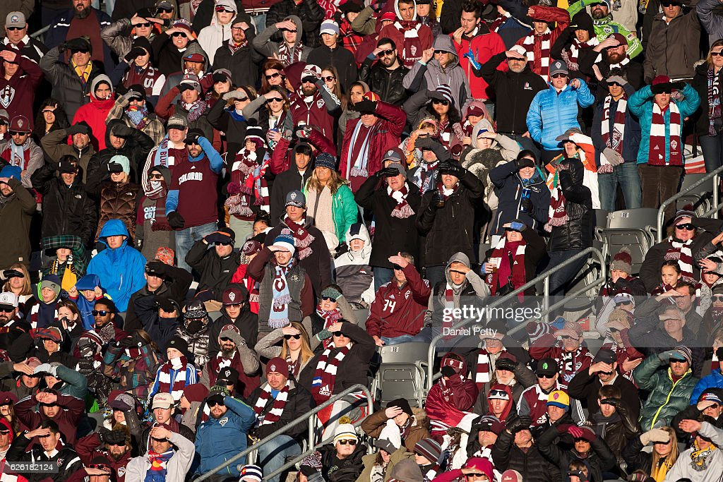 Colorado Rapids fans shield their eyes from the sun during the second leg of the Western Conference Finals against the Seattle Sounders at Dick's Sporting Goods Park on November 27, 2016, in Commerce City, Colorado. Seattle won the match 1-0 to move on to the MLS final.