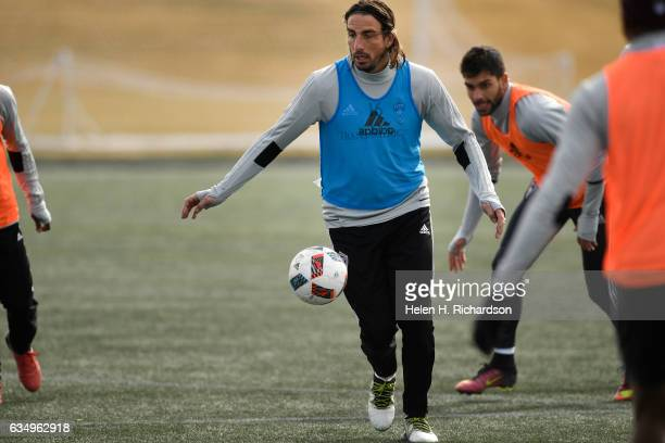 Colorado Rapids forward Alan Gordon #16 middle moves the ball up field during soccer practice on the practice fields at Dick's Sporting Goods Park on...
