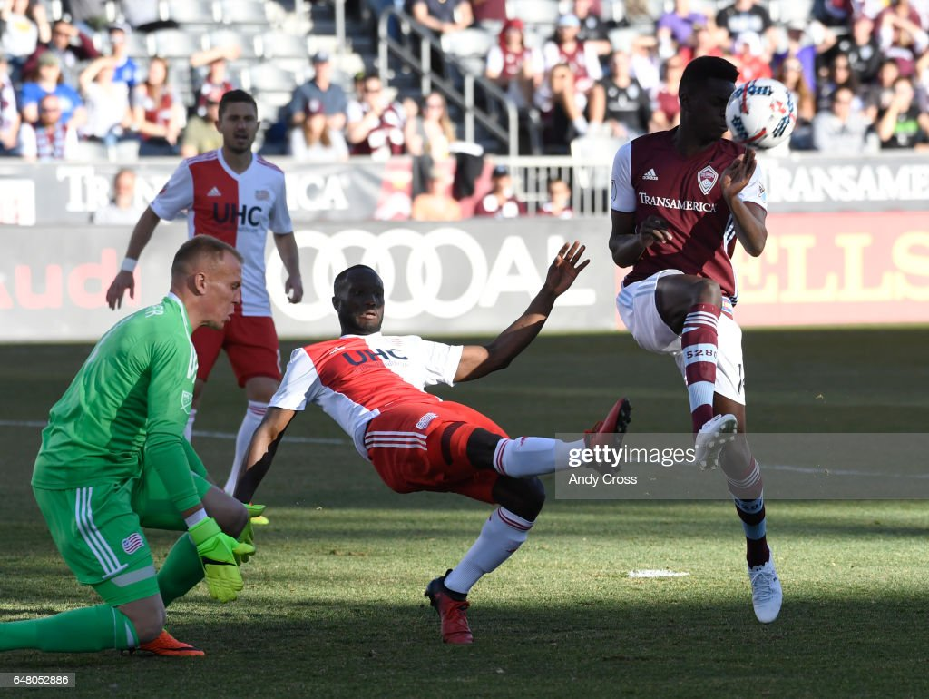 Colorado Rapids forward Dominique Badji #14 has a chance for a goal against New England Revolution goalkeeper Cody Cropper #1 and New England Revolution defender Angoua Brou Benjamin #4, but was unable to score in the first half at Dick's sporting Goods Park March 04, 2017.