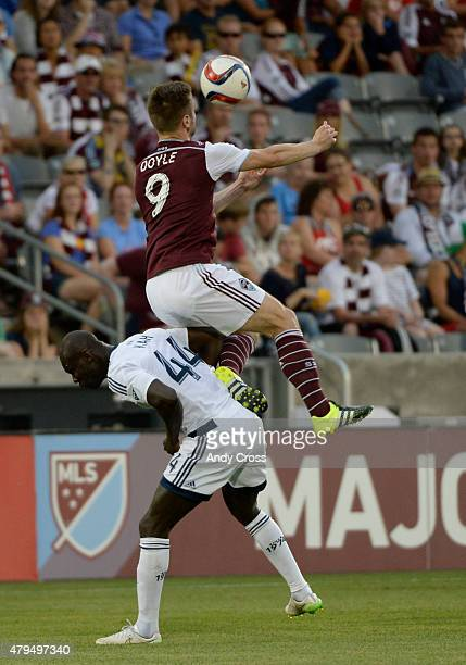 Colorado Rapids forward Kevin Doyle goes up for a header against Vancouver FC defender Pa Modou Kah in the first half at Dick's Sporting Goods Park...