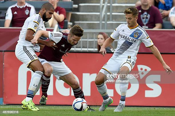 Colorado Rapids forward Kevin Doyle is defended by Los Angeles Galaxy defender Todd Dunivant and defender Robbie Rogers during the first half of...