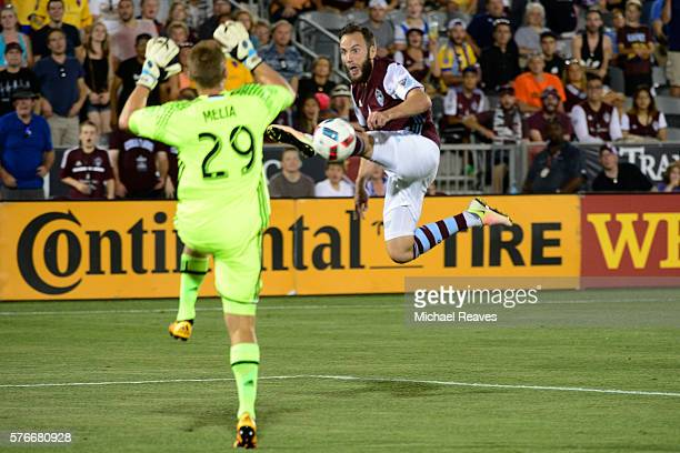Colorado Rapids forward Shkelzen Gashi takes a shot on Sporting Kansas City goalie Tim Melia during the game at Dick's Sporting Goods Park on July 16...