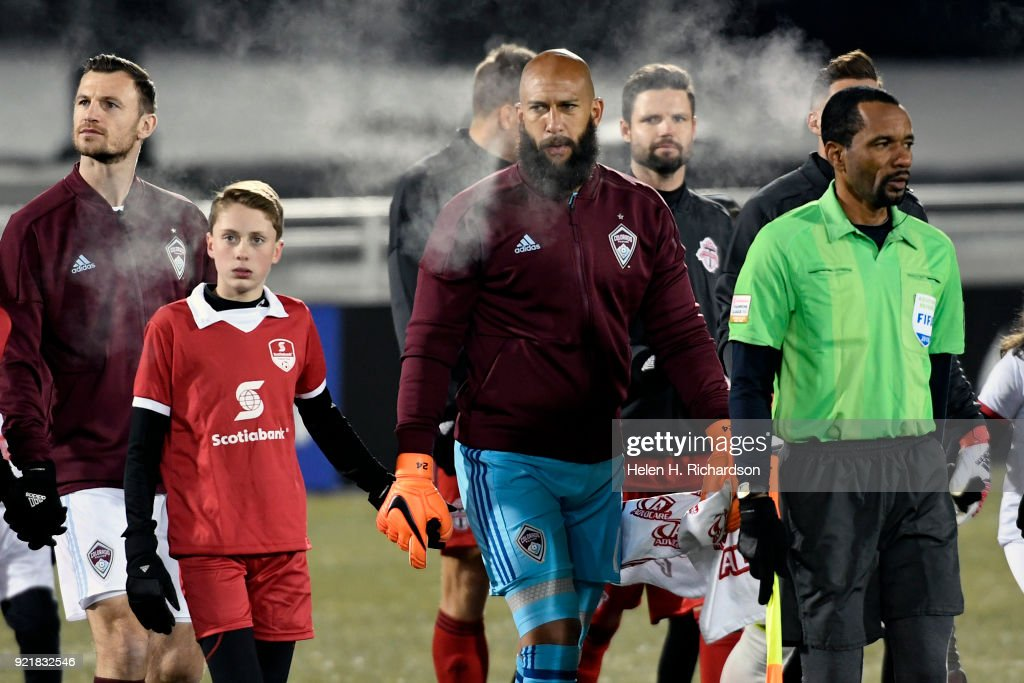 Colorado Rapids goalkeeper Tim Howard, middle, walks onto the field before the game as temperatures plummet to 3 degrees at the start of the game on February 20, 2018 in Commerce City, Colorado. This is the first round of 16 in the CONCACAF Champions League game at Dick's Sporting Goods Park. The Colorado Rapids take on the defending MLS Cup champs in tonight's game. The coldest game on record is 19 degrees at kickoff. Tonight's game could be much colder.