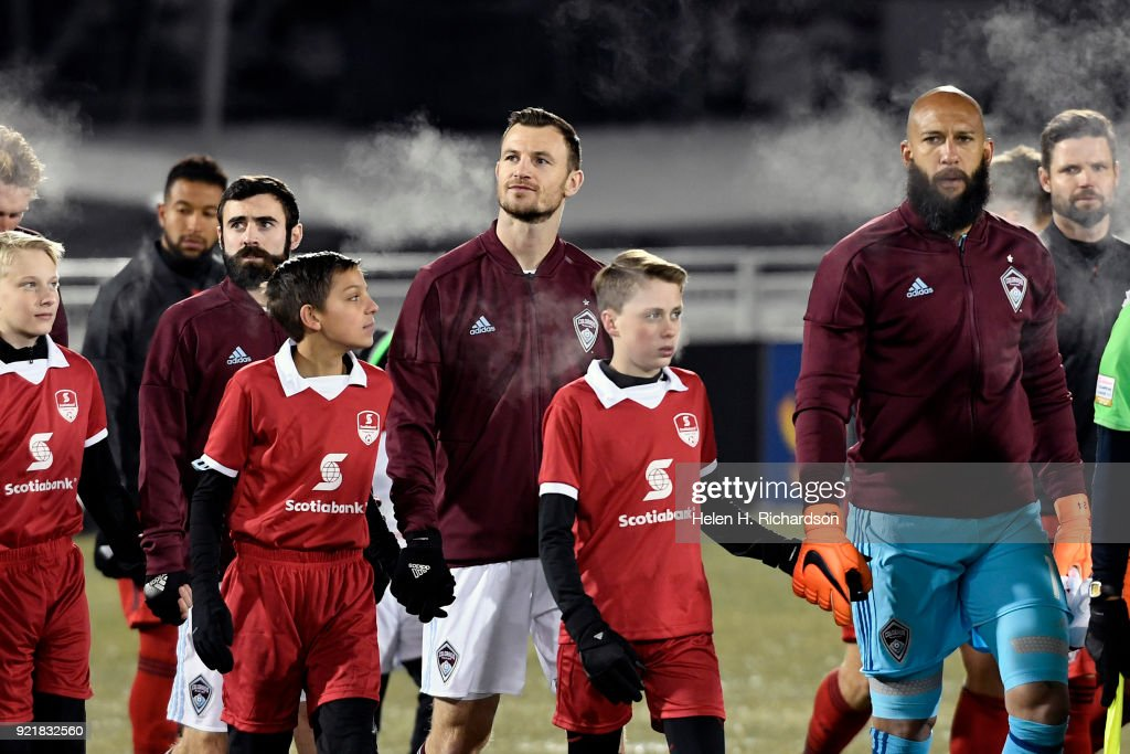 Colorado Rapids goalkeeper Tim Howard, right, and Tommy Smith, middle, walk onto the field before the game as temperatures plummet to 3 degrees at the start of the game on February 20, 2018 in Commerce City, Colorado. This is the first round of 16 in the CONCACAF Champions League game at Dick's Sporting Goods Park. The Colorado Rapids take on the defending MLS Cup champs in tonight's game. The coldest game on record is 19 degrees at kickoff. Tonight's game could be much colder.