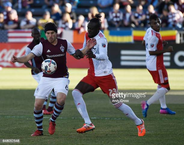 Colorado Rapids midfielder Dillon Powers and New England Revolution forward Kei Kamara battle for control of the ball in the first half at Dick's...