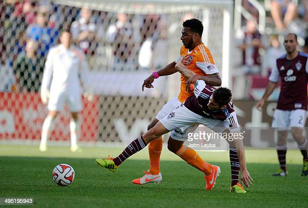 Colorado Rapids midfielder Jose Mari battle for the ball with Houston Dynamo midfielder Giles Barnes during the first half June 1 2014 at Dick's...