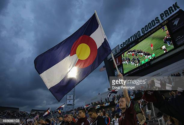 Colorado Rapids supporter waves the Colorado flag as the team take the field to face the the Montreal Impact at Dick's Sporting Goods Park on May 24,...