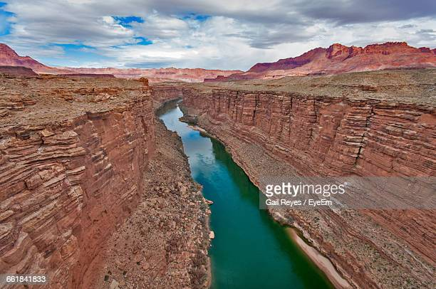 Colorado River Amidst Rock Formation At Grand Canyon National Park