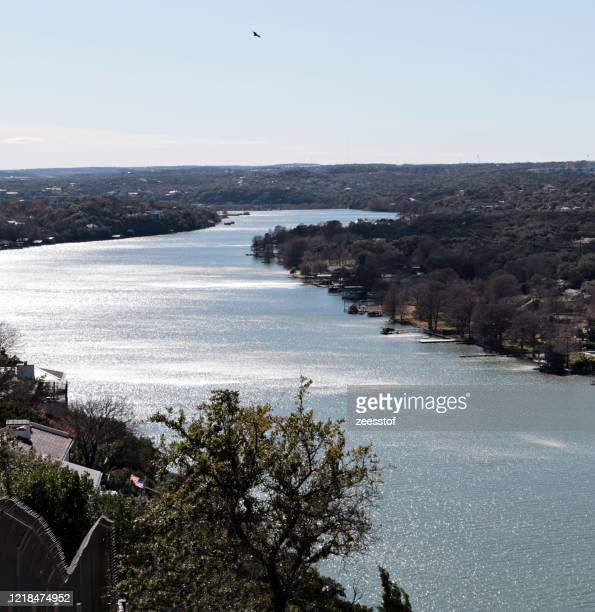 colorado river, austin - zeesstof stock pictures, royalty-free photos & images