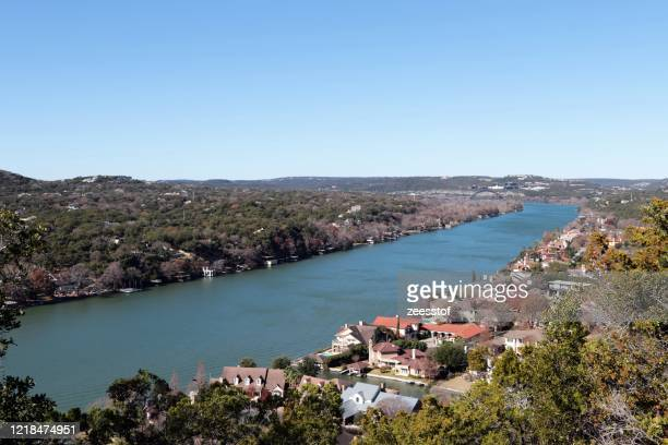 colorado river from cover park, austin - zeesstof stock pictures, royalty-free photos & images