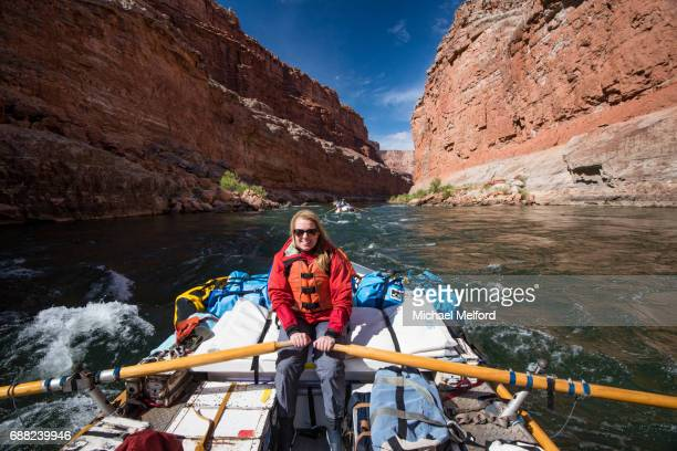 colorado river , guest rowing the raft thru the grand canyon - leanincollection stock pictures, royalty-free photos & images