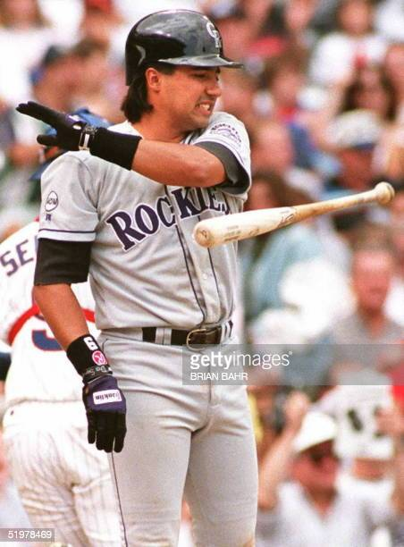 Colorado Rockies batter Vinny Castilla tosses his bat in the air after striking out against Chicago Cubs pitcher Jaime Navarro in the sixth inning 01...
