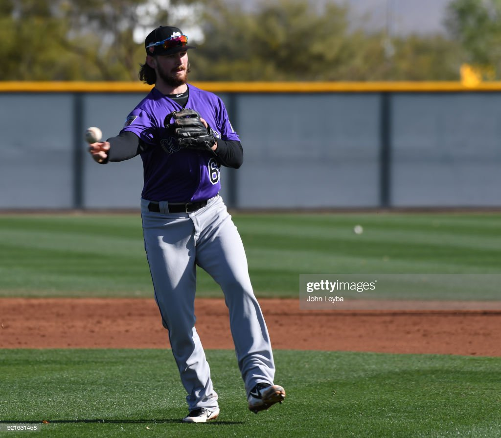 Colorado Rockies Brendan Rodgers (65) throws to first base during drills on February 20, 2018 at Salt River Fields at Talking Stick in Scottsdale, Arizona.
