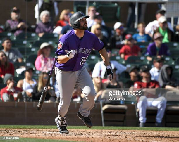 Colorado Rockies catcher Anthony Bemboom homers in the seventh inning to right center against the Arizona Diamondbacks on February 28 2018 at Salt...