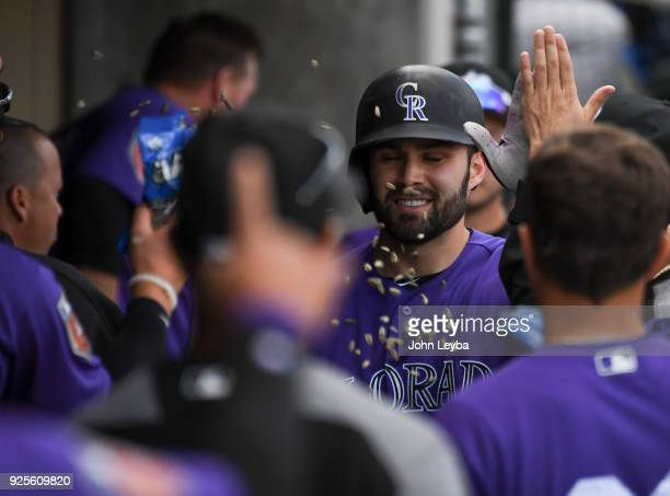 Colorado Rockies catcher Anthony Bemboom is showered with sunflower seeds in the dugout after his homer in the seventh inning to right center against...