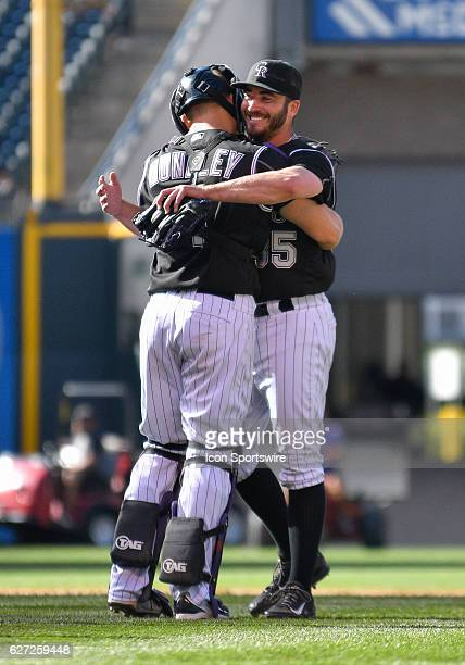 Colorado Rockies Catcher Nick Hundley [5939] congratulates Colorado Rockies Starting pitcher Chad Bettis [8302] after pitching a shutout the game...