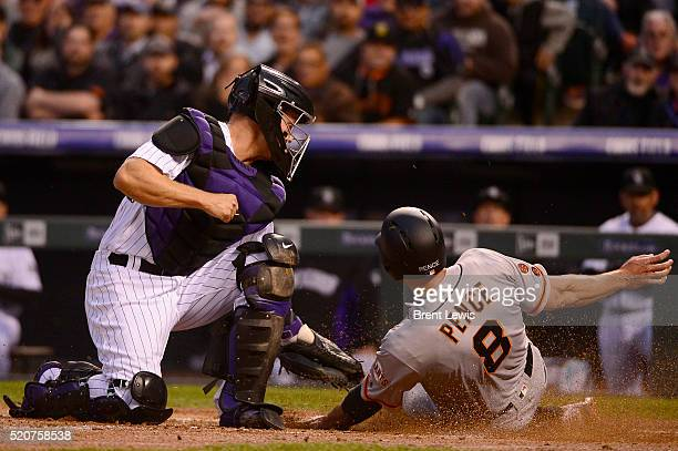 Colorado Rockies catcher Nick Hundley tags San Francisco Giants right fielder Hunter Pence as he tries to slide into home during the third inning at...