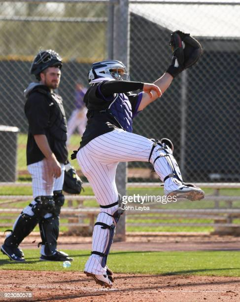 Colorado Rockies catcher Tony Wolters goes up high for the ball in drills during the teams workout on February 22 2018 at Salt River Fields at...