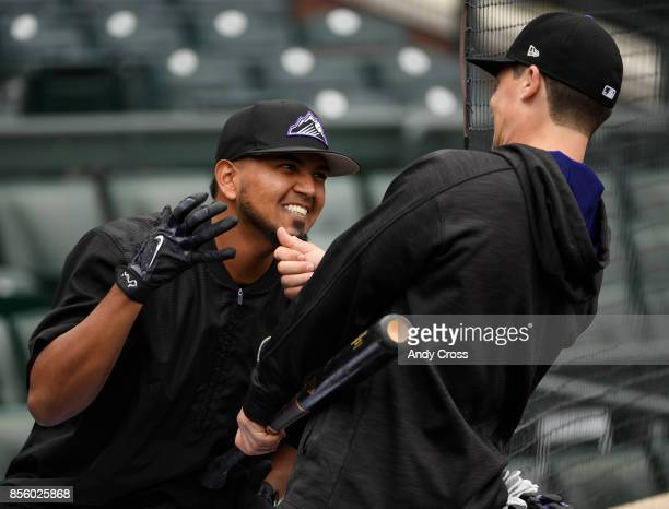 Colorado Rockies catcher Tony Wolters right tugs on the goatee of Colorado Rockies starting pitcher German Marquez during warmups before playing the...