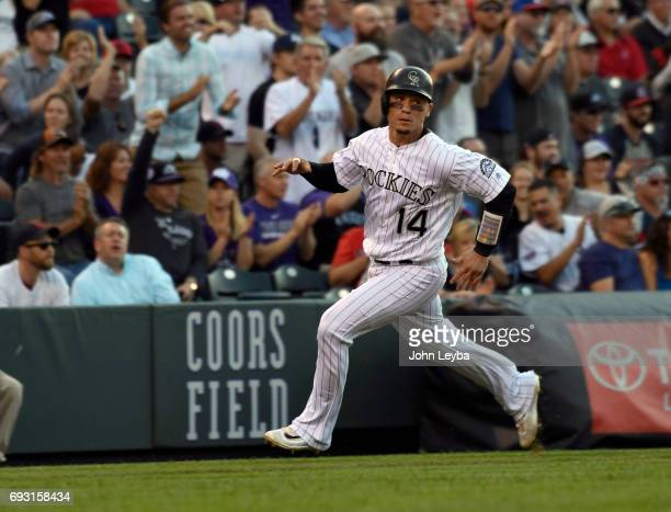 Colorado Rockies catcher Tony Wolters sprints home for a score after a double by Colorado Rockies starting pitcher Antonio Senzatela double against...