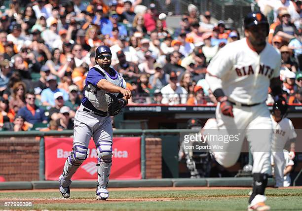 Colorado Rockies catcher Wilin Rosario throws out San Francisco Giants Hector Sanchez going to first base on a dropped third strike during a Major...