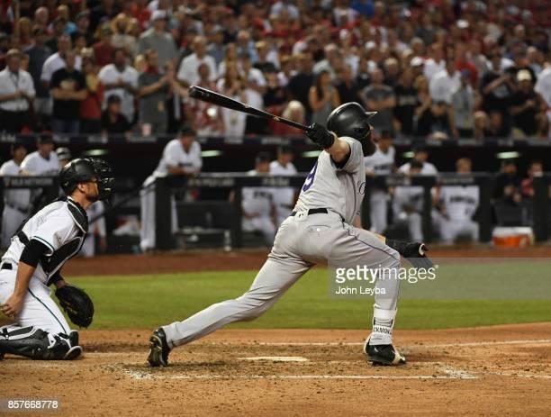 Colorado Rockies center fielder Charlie Blackmon flies out to Arizona Diamondbacks center fielder AJ Pollock for the third out in the fourth inning...