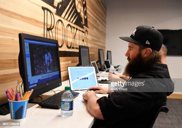 Colorado Rockies center fielder Charlie Blackmon reviews his video stats stance hitting techniques and scouts pitching from the video room near the...