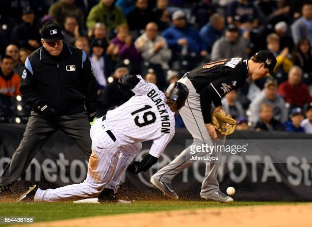 Colorado Rockies center fielder Charlie Blackmon slides in at third base safe on a second baseman DJ LeMahieu single to right field as Miami Marlins...