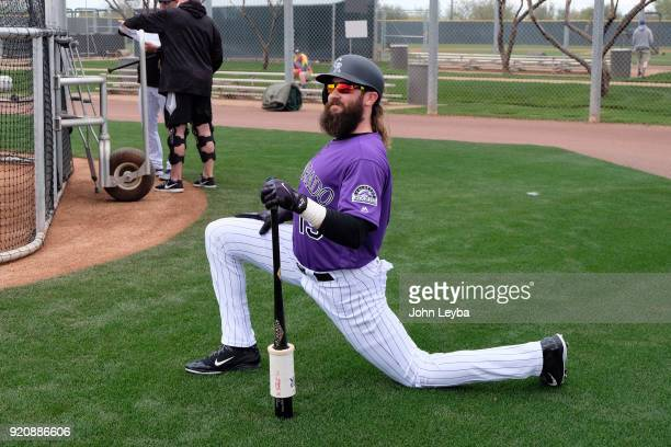 Colorado Rockies center fielder Charlie Blackmon stretches before steeping in to the cage for batting practice during the teams workout on February...