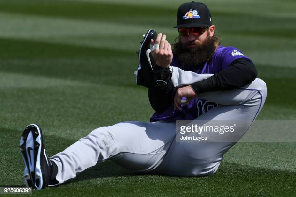 Colorado Rockies center fielder Charlie Blackmon stretches prior to the game against the Arizona Diamondbacks on February 28 2018 at Salt River...
