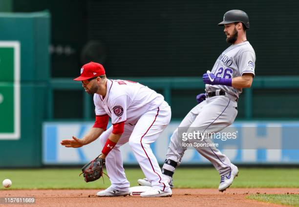 Colorado Rockies center fielder David Dahl goes into second base with a double ahead of the throw to Washington Nationals second baseman Brian Dozier...