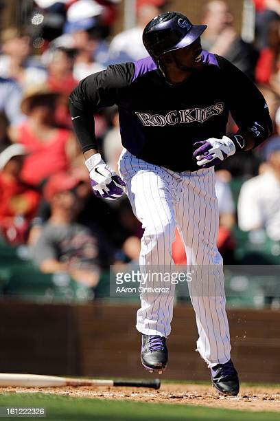 Colorado Rockies center fielder Dexter Fowler makes contact against the Arizona Diamondbacks during the first game of Spring Training at Salt River...