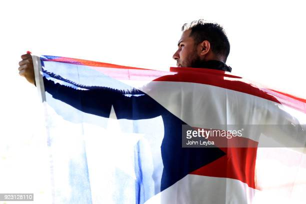 Colorado Rockies center fielder Noel Cuevas poses with the Puerto Rico flag after practice on February 20 2018 at Salt River Fields at Talking Stick...