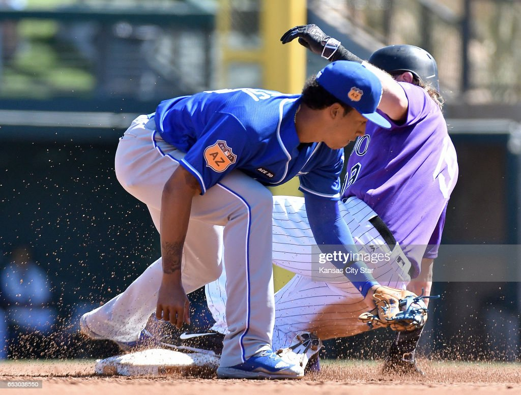 Colorado Rockies' Charlie Blackmon steals second before the tag from Kansas City Royals second baseman Raul Mondesi in the first inning during a spring training baseball game on Monday, March 13, 2017 in Scottsdale, Ariz.