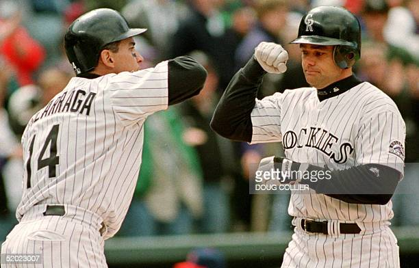 Colorado Rockies Dante Bichette is congratulated by Andres Galarraga after Bichette hit a two run home run in the sixth inning of their game 01 May...