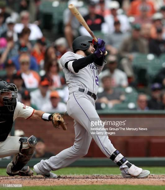 Colorado Rockies' David Dahl hits a grand slam home run off San Francisco Giants starting pitcher Jeff Samardzija in the third inning of their MLB...