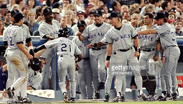 Colorado Rockies Eric Young is congratulated by his teammates after hitting a two run home-run in the third inning against the Atlanta Braves 06...