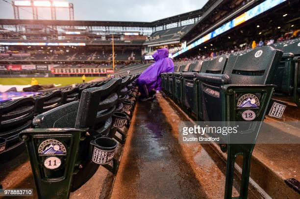 Colorado Rockies fans Rob Durbin and Marsha Schricker hold out hope for a game to be played during a weather delay and tornado watch before a...