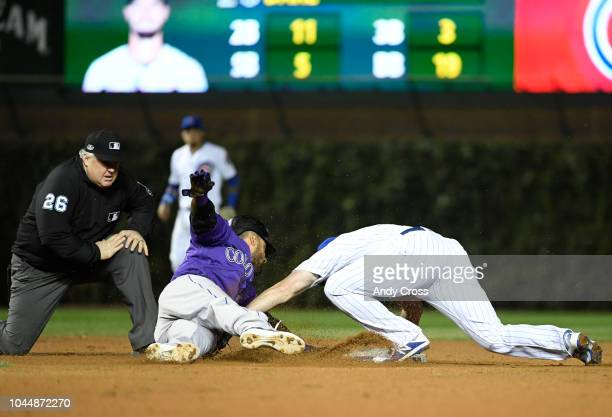Colorado Rockies first baseman Ian Desmond tagged up at first and was thrown out at second by Chicago Cubs second baseman Daniel Murphy on a fly out...