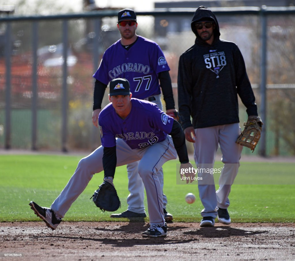 Colorado Rockies first baseman Jordan Patterson (25) scoops s a grounder during th teams workout on February 20, 2018 at Salt River Fields at Talking Stick in Scottsdale, Arizona.