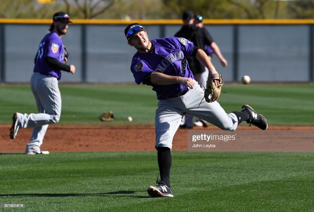 Colorado Rockies Garrett Hampson (68) throws to first during drills on February 20, 2018 at Salt River Fields at Talking Stick in Scottsdale, Arizona.