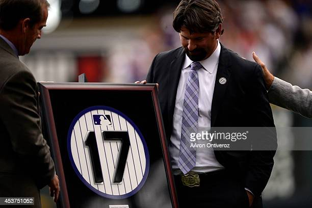 Colorado Rockies great Todd Helton stands with a replica of his retired number 17 during a retirement ceremony held in his honor Helton who played 17...