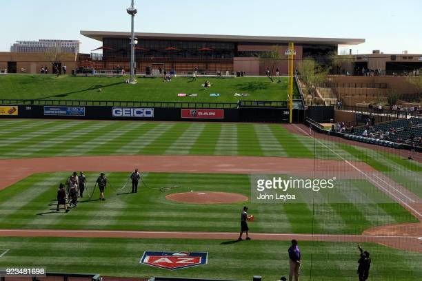 Colorado Rockies grounds crew prepares the field as they get ready for opening day against the Arizona Diamondbacks on February 23 2018 at Salt River...