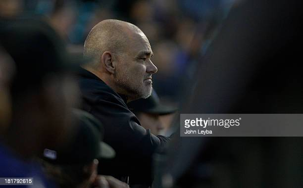 Colorado Rockies hitting coach Dante Bichette watches from the dugout Boston Red Sox September 24, 2013 at Coors Field. Bichette announced he will...
