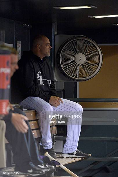 Colorado Rockies hitting coach Dante Bichette watches from the dugout Boston Red Sox September 24 2013 at Coors Field Bichette announced he will...
