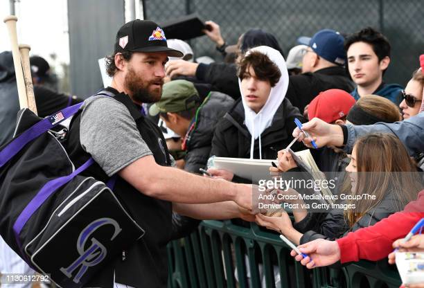 Colorado Rockies infielder Daniel Murphy signs autographs for the fans after practice at Salt River Fields February 18 2019